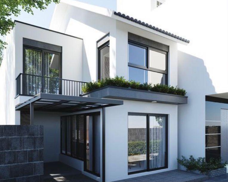 Rumah tingkat minimalis dengan pintu masuk dari samping
