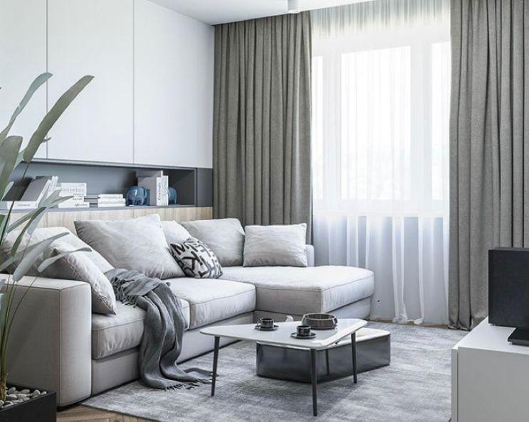 ruang tamu minimalis abu-abu dengan kabinet putih